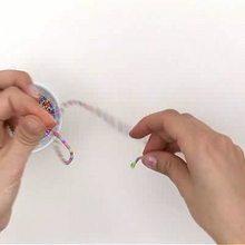 Video de fabricar una pulsera de perlas