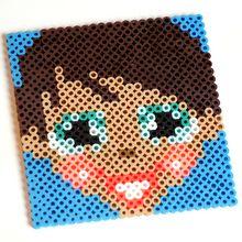 Manualidad infantil : Cara de niña en perlas para planchar