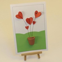 Carta con corazones en relieve