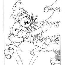 Dibujo para colorear : Papa Noel  con un regalo sorpresa